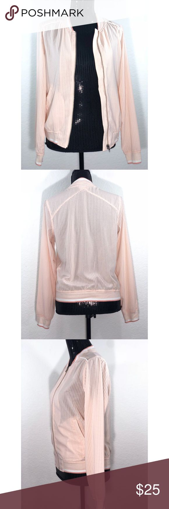 """Pre-Owned Women's Bomber Jacket - Merona Peach S The soft Women's Bomber Jacket by Merona in Peach gives you versatile femininity in a delicate hue. Stay comfortable and fresh-looking in this women s lightweight jacket.  Approximate Measurements Length: 21.5"""" Sleeves: 26"""" Merona Jackets & Coats"""