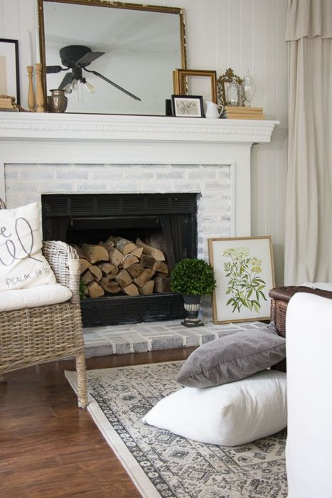 Painted brick fireplace with large rectangular mirror on mantel