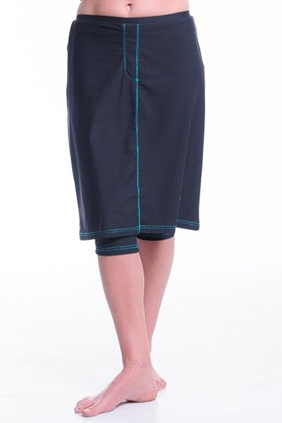 This fabulously stylish long swim skirt has the fashion of a denim skirt and versatility of a swim and sports skirt. Slimming Leggings slightly peeping out from underneath provide extra coverage and mobility so that you can swim, run and bike in style without a care.