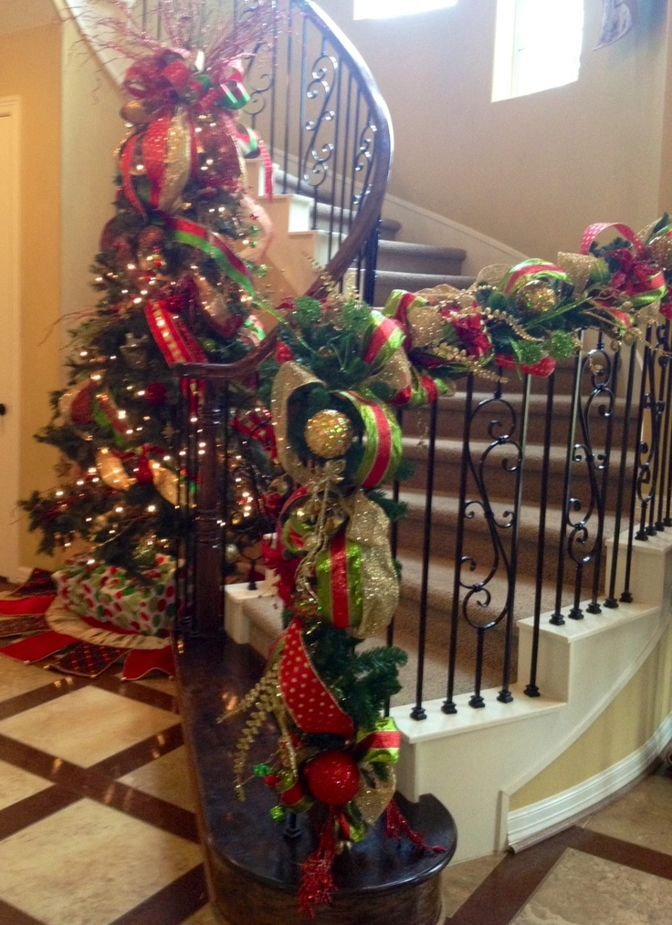 Christmas tree and decorated garland in red, gold and green.