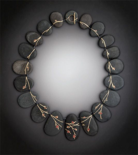 Absolutely beautiful - and all her other work is too! Reclaimed precious metals and gems inlaid into found beach stones.