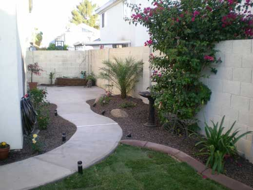 Cement Ideas For Backyard front walkway built out of inexpensive cement pavers red lava rocks and solar lights Idea For Our Long Side Yard So Its Not All Cement Or Grass