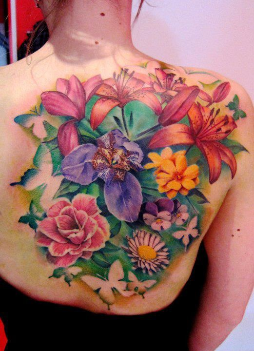 Colorful flower garden tattoo on back | Tattoo ideas I've ...