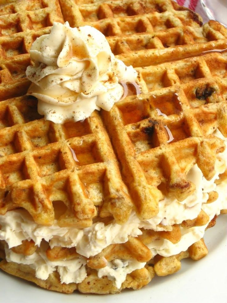 Carrot Cake Waffles - Delicious buttermilk waffles with cinnamon, raisins, chopped walnuts and grated carrots topped with Maple Nut Cream Cheese spread.