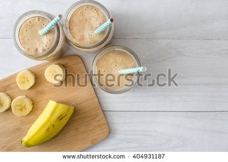 Banana smoothie on a white wooden table