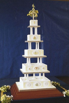 Wedding Cake of Prince Andrew and Sarah Ferguson (1986).  Prepared at the Royal Navy Cookery School in Torpoint, England, this white- and yellow-iced cake incorporated five tiers, weighed 240 pounds, and reached five and a half feet tall. The marzipan cake recipe used 15 ingredients and featured rum, brandy, and port flavors.