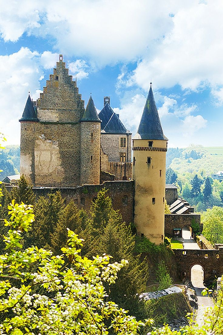 Vianden castle in Luxembourg sits on top of the city.  Click through to see 20 of the most BEAUTIFUL fairy tale castles in the world!