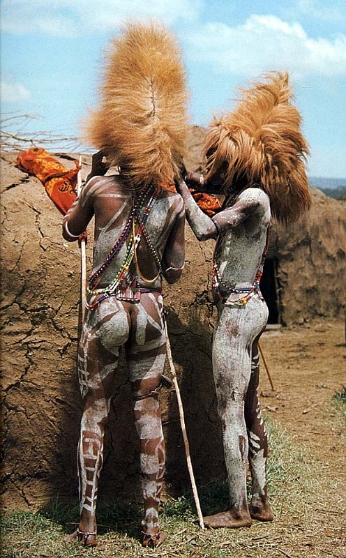Maasai Warriors wearing hats made from the mane of a lion that they have each killed. When the warrior becomes a Junior elder he must throw the lion mane head gear away through a sacrificial event to keep off bad spirits | Photographer ?