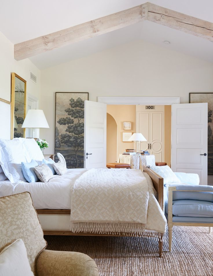 Pacific Palisades No. 2 - Mark D. Sikes - exquisite bedroom in pale neutrals and light blue - love the doors in the distance. They look to be by Metrie