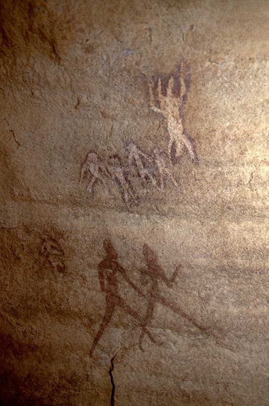 Djanet, Algeria. Large Round Head Period paintings in a sandstone shelter of people standing, walking and appearing to float in space. http://africanrockart.org