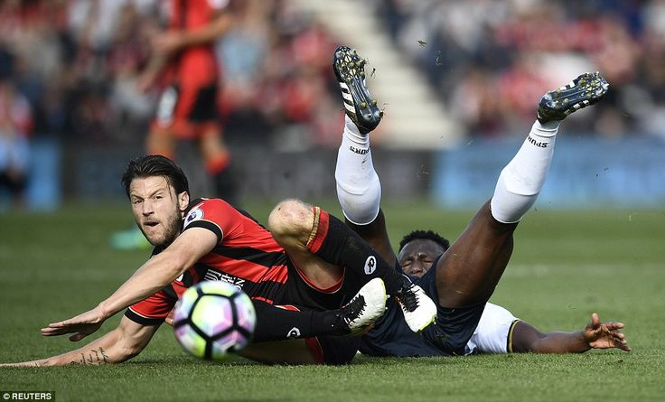 Harry Arter (left) makes a firm but fair challenge on Victor Wanyama as things became feisty on the pitch