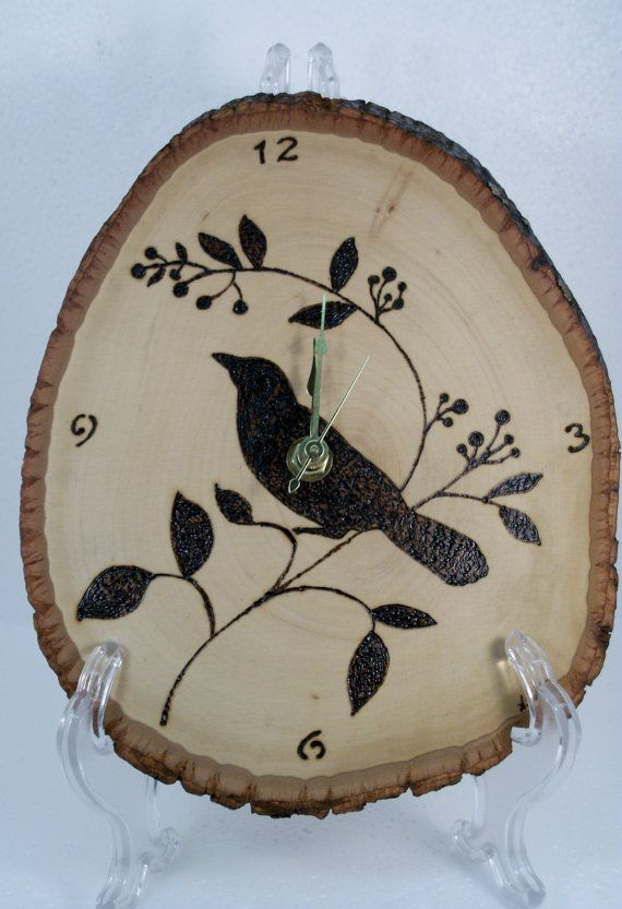 This clock is made out of an approximately 8x10 inch piece of basswood. The bird has been intricately woodburned into the all natural piece of basswood. Hour markers for 12, 3, 6 and 9 are burned into the wood.    The clock operates on a single AA battery (not included). It features an hour hand, a minute hand and a second hand.