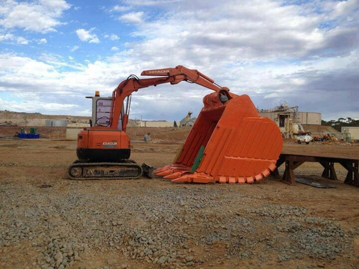 Mighty mini.Thats bucket weighs more then the HItachi  mini excavator pictured