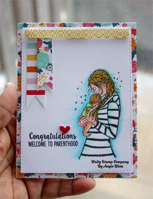 """BRAND NEW on the UNITY Website! Created by Angie Blom. This kit contains 3 stamps. Mama holding baby measures approximately 1.5"""" x 3.25"""". """"Congratulations welcome to parenthood"""" sentiment measures approximately .5"""" x 1.75"""". """"a mother's arms are more comforting than any other"""" sentiment measures approximately .75"""" x """". All Unity Stamps are pre-cut, mounted on cling foam and ready to use right out of the package – you can mount our stamps on any acrylic block. Unity is known for its H..."""