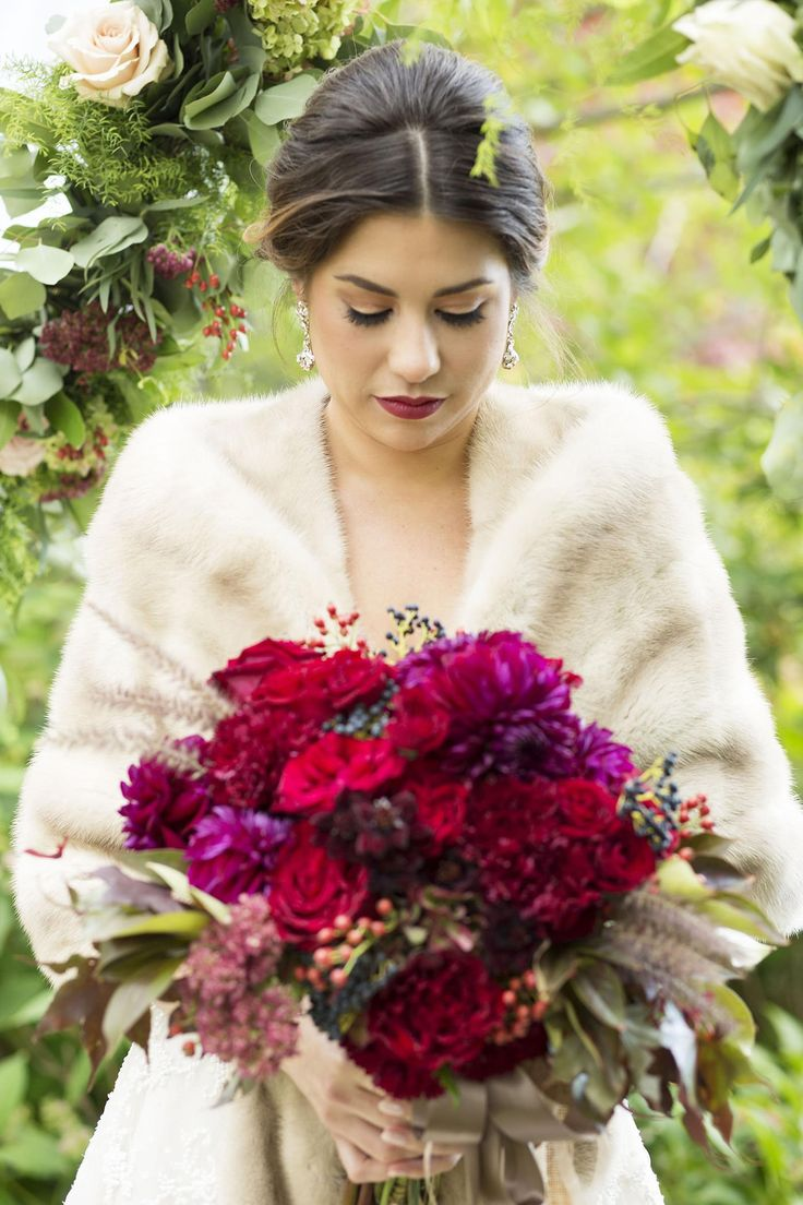winter wonderland wedding south africa%0A Winter bridal style  wedding fashion  fur wrap  red bouquet  luxe bride