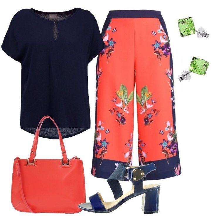Un outfit primaverile all'insegna del colore: ecco il pantalone rosso vivo, in una splendida ed allegra fantasia floreale, vestibilità a zampa, lunghezza 7/8, abbinato a camicetta blu scuro, scollo tondo, chiuso con bottone, manica corta, vestibilità normale. Comodo sandalo blu con tacco largo, elastico, applicazione in metallo, borsa a mano corallo misura media, similpelle, chiusa con zip, doppio manico, tasca interna con zip, tracolla removib...