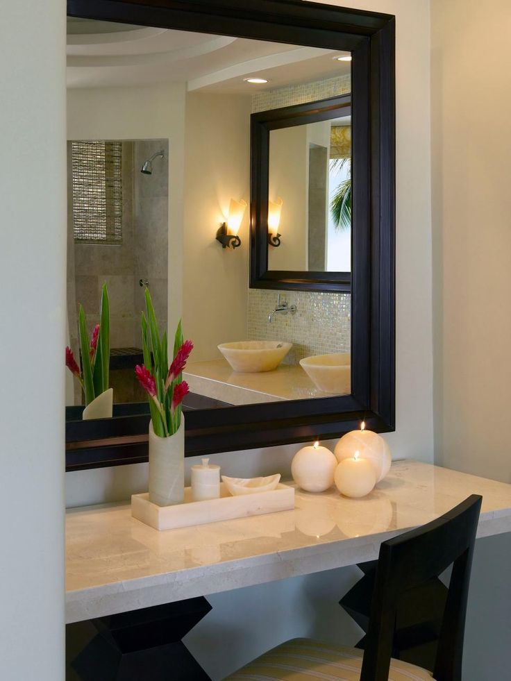 A sleek stone vanity with black framed mirror and chair provides an ideal place for doing. 1000  ideas about Black Framed Mirror on Pinterest   Framed