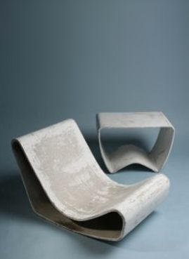 outdoor concrete loop chair designed by Willy Guhl in 1954.