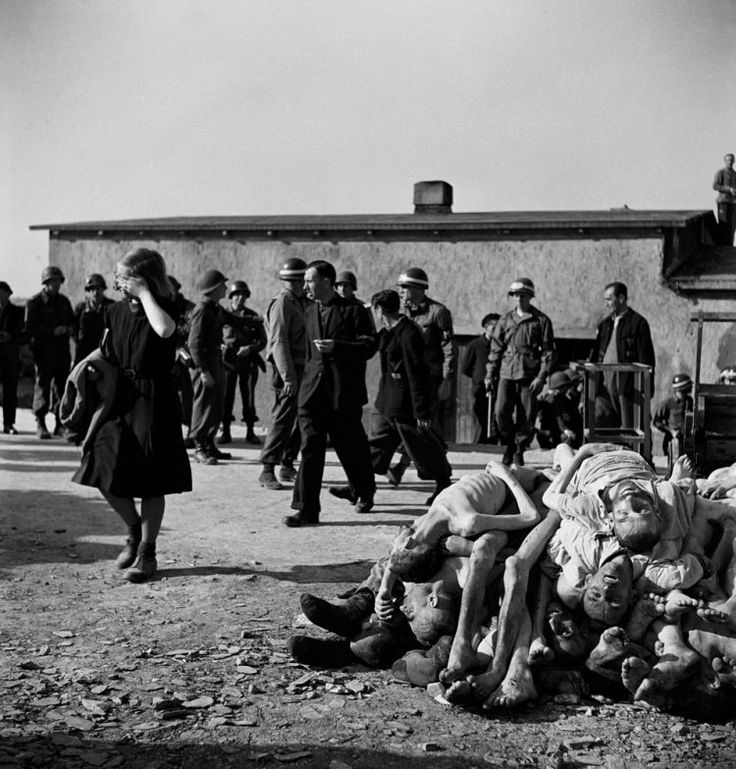 """Inside 1945 Buchenwald with LIFE: """" German civilians are forced by American troops to bear witness to Nazi atrocities at Buchenwald concentration camp, mere miles from their own homes, April 1945."""""""