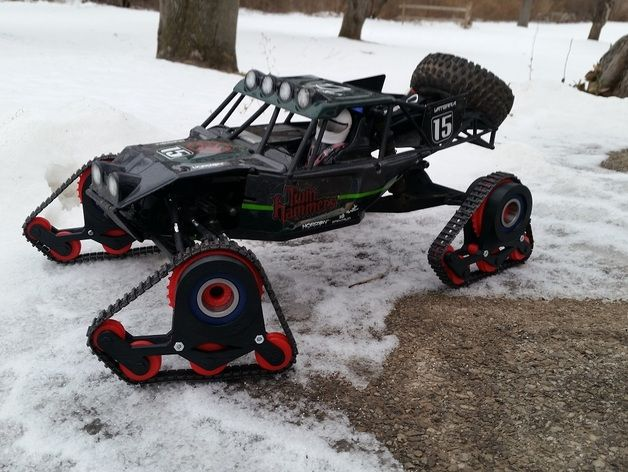 Tracks for 1/10 scale RC car / truck / buggy in style of Mattracks.  I made them for my Vaterra Twin Hammers to drive in the snow.  The tread and axles are from a Tamiya 70100 Track and Wheel Set.    Video of the tracks in action: http://youtu.be/Olw4WwAe8B8