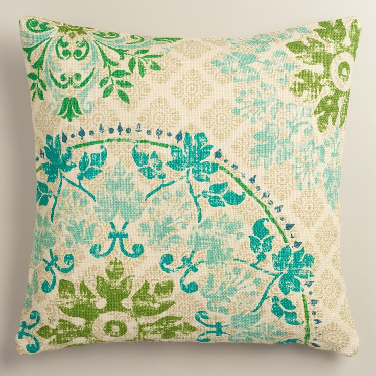 Crafted of 100% natural jute that has been washed for added softness, our exclusive throw pillow features an intricate medallion print with pops of green and blue.