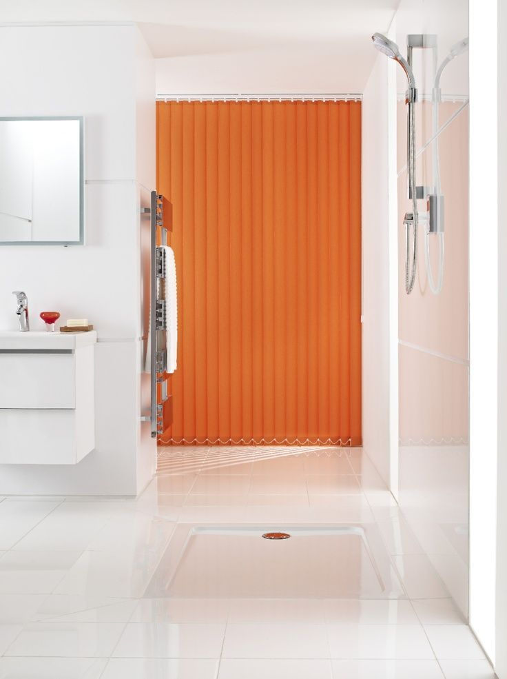 Add colour in a white room with bright accessories to make a dramatic impression. Made to measure orange vertical blinds are perfect to finish the look.