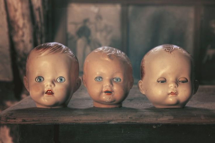 Terrifying haunted doll heads