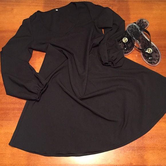 Sheer black dress with slit sleeves Very cute sheer black dress with v neck and slits in sleeves. Loose fit.  Great any time of year! Bundle and save! Dresses Mini
