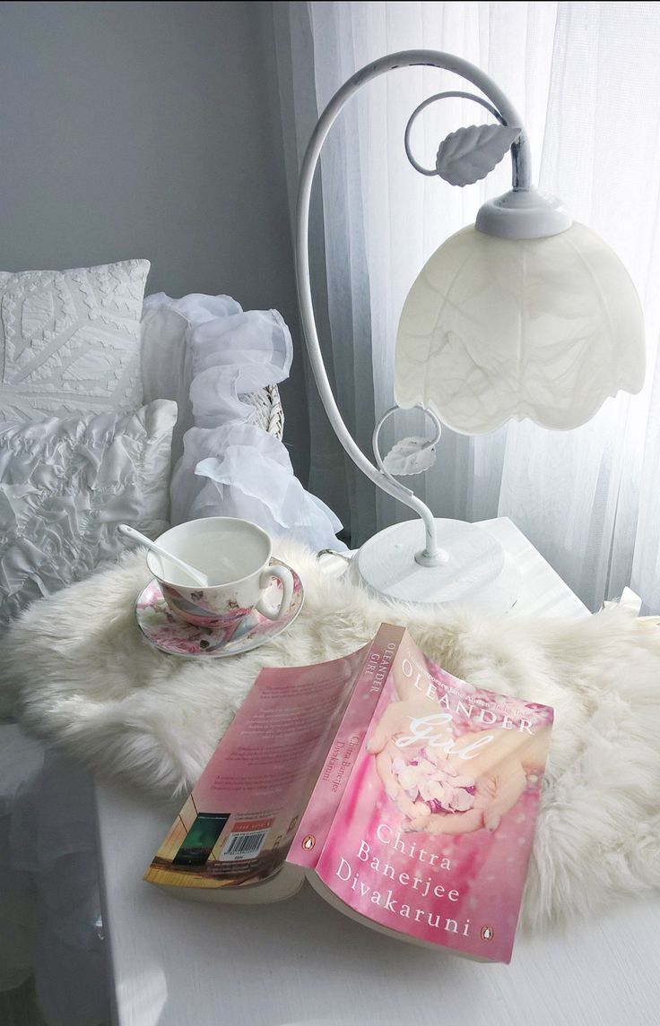 A meeting of two worlds: reading Indian book in a winter atmosphere of room. Designed by Urszula Koronczewska.