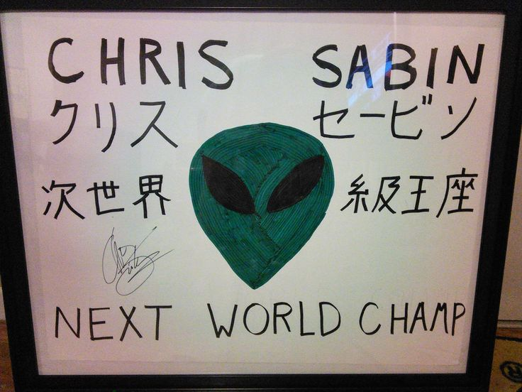 "Chris Sabin ""Next World Champ"" sign autographed by Chris Sabin."