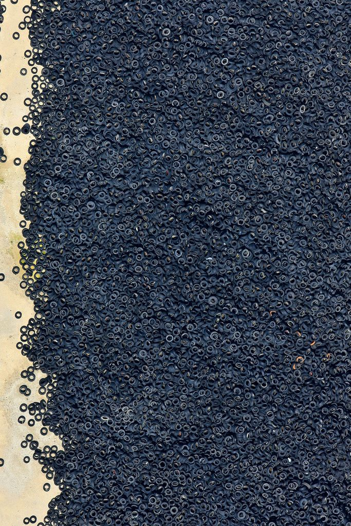 Aerial photography - used tires. We need to find a million ways to productively reuse these things. There are SO MANY of them. And they ooze unhealthiness into the groundwater.....