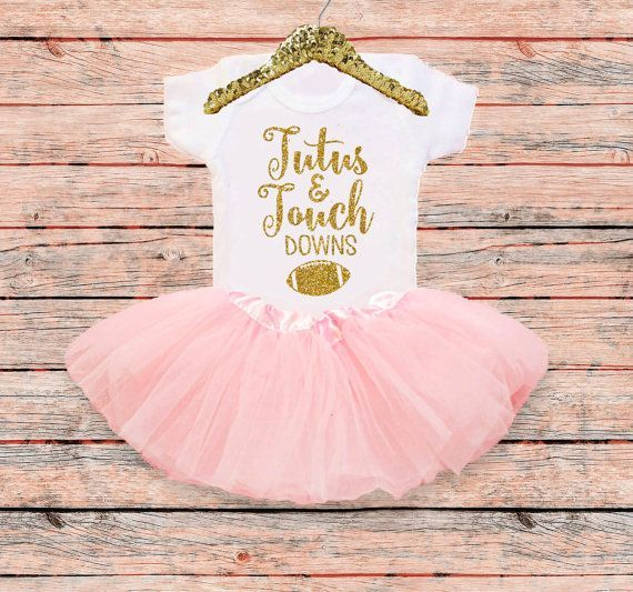 Tutus and Touchdowns New Baby girl coming home outfit, Pink and Gold Outfit. Newborn Outfit  :hearts:Outfit:hearts: Optional 2 pc Baby girl Sparkle outfit with Tutu  Your perfect little lady will be stylish and comfy in this adorable 100% cotton baby girl bodysuit! Features Tutus and Touchdowns in NO flake sparkle glitter, Premium quality material. This baby girl outfit makes a precious coming home outfit, baby shower gift, or wonderful surprise for any soon to be mommy or daddy…