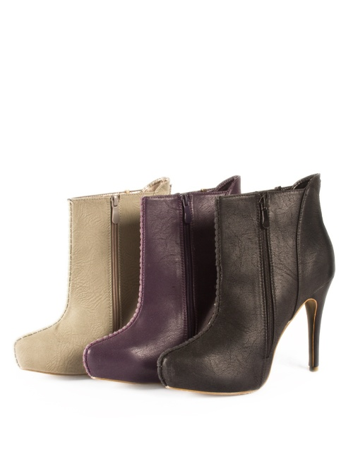 High heel ankle boots with details on the front. Heel height: 12cm, internal platform: 2cm. #fw13 #fashion #womensfashion #ankleboots #highheels #shoes