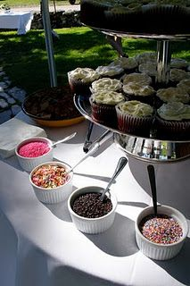A cupcake bar, so cute. Plain cupcakes and with topping choices!