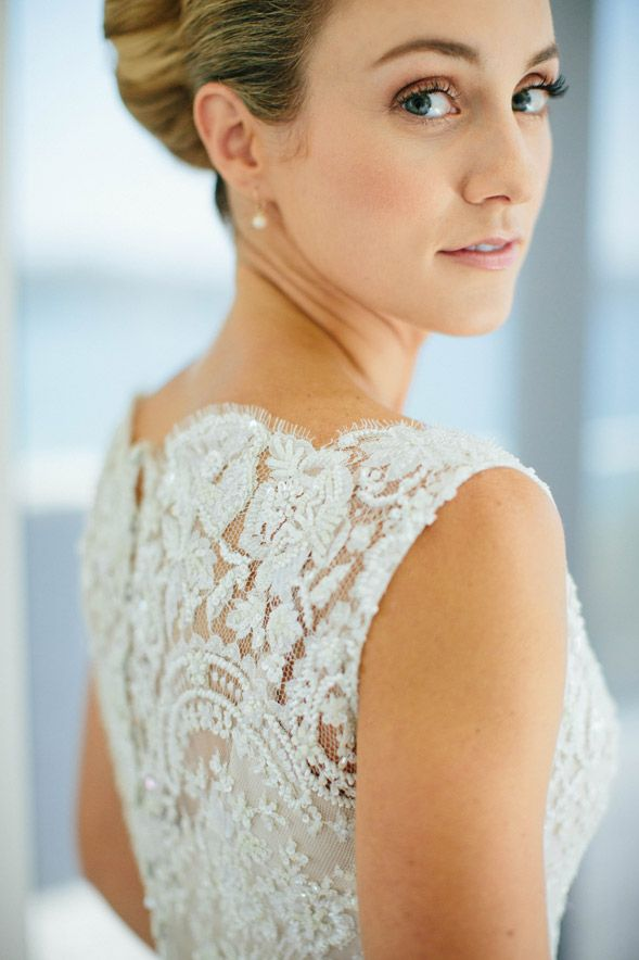 Stunning Alex wore one of our favourite wedding dresses this season! She picked for her big day an exquisite piece of French Chantilly, detailed withintricate,...