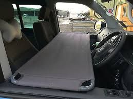 Image result for making a bed in the front seat of a van