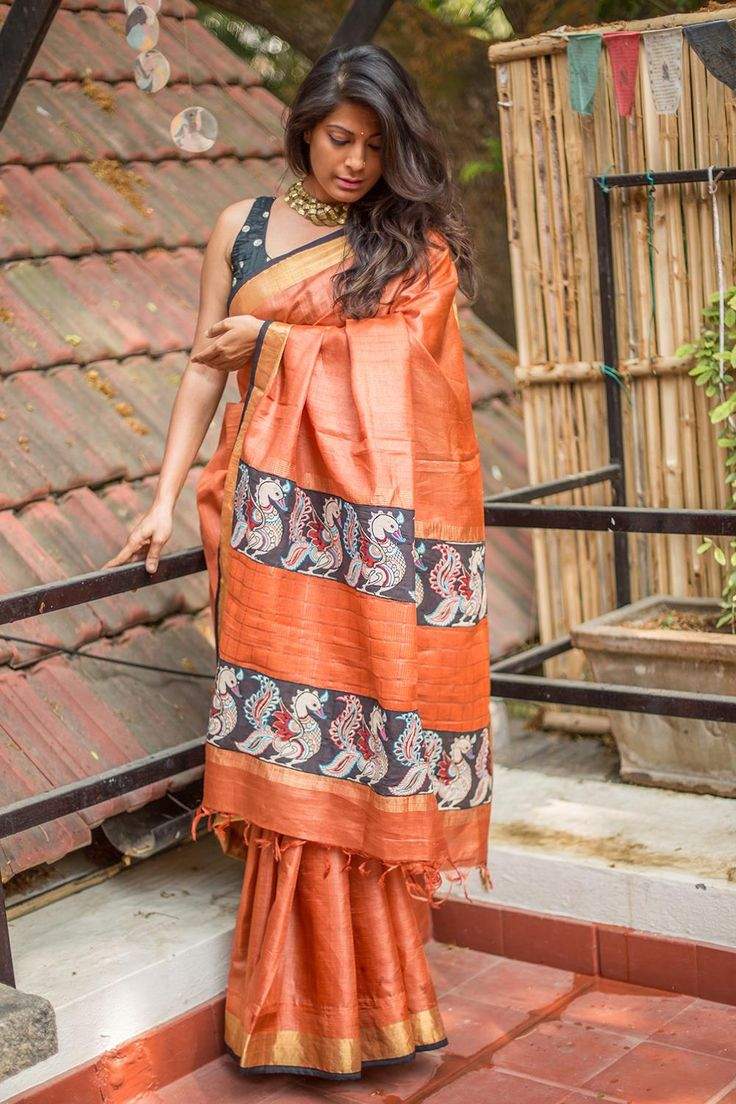 Our sellout rust orange drape is back! This time is a deeper rust color with a red black and white Kalamkari pallu detail. Classy and simple.A no brainer pairing of a black or a red blouse. Or do a gold tissue blouse and sparkle away! #kalamkari #saree #India #blouse #houseofblouse