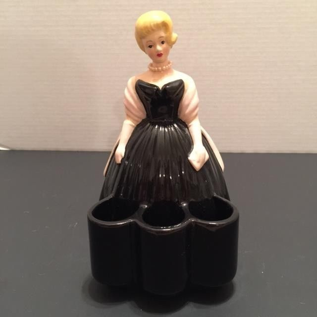 """His is a very Beautiful Lady dressed in a black dress with pink shawl, approx 5""""x9""""she has blonde hair and 3 compartments for lipstick in front of her dress and holds cosmetic brushes or whatever in back of dress, she is wearing pearls and holding pink handbag. 