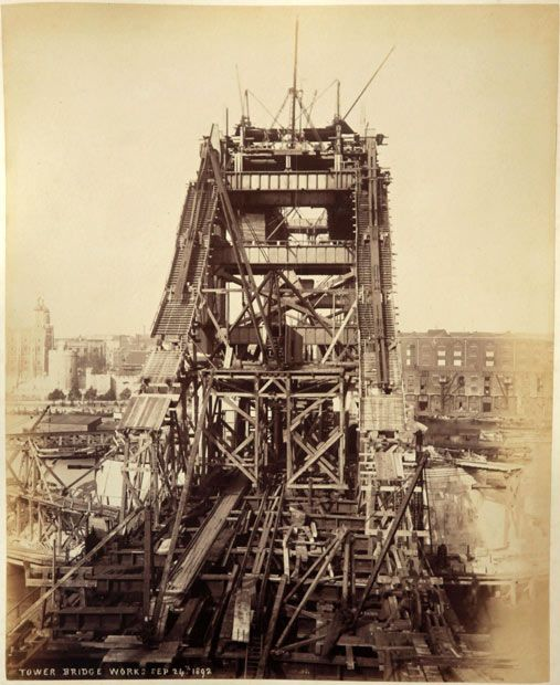 London's Tower Bridge under construction. The construction of Tower Bridge was begun in 1886, and the bridge was finished in 1894.