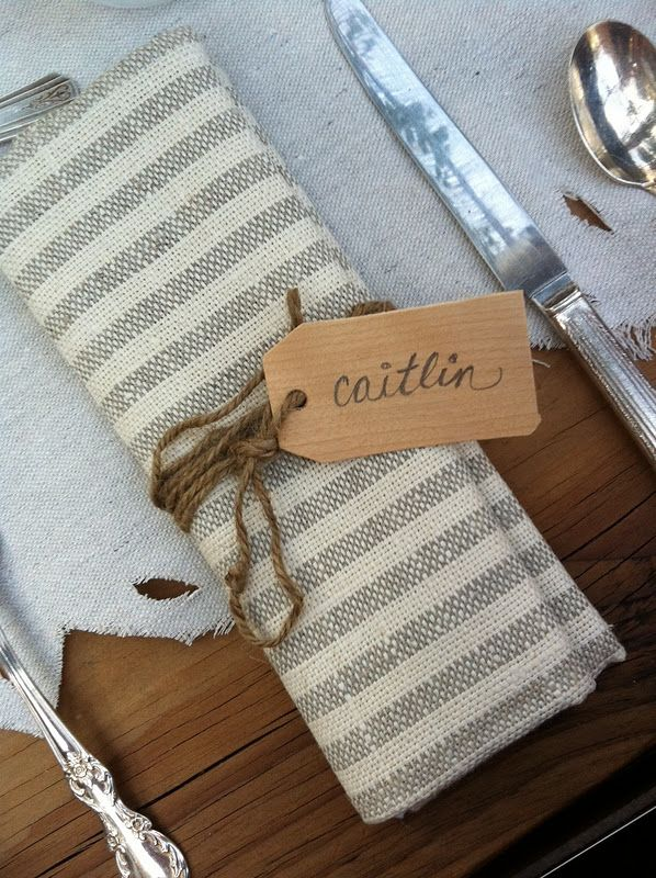 If we do seating arrangements, this would be adorable name place with twine wrapped around a colored napkin...