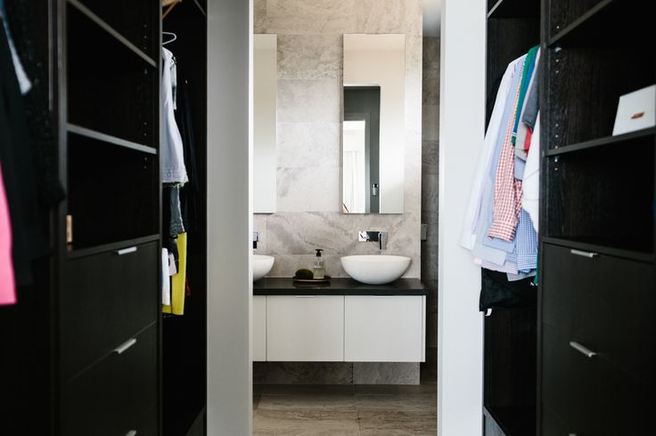 Walk through robe, and what do we see....a beautiful en suite in front of me! +Planet Luxe! The Murnane Residence, A GD&C project Photo by Tara Pearce, Styling by Stephanie Somebody