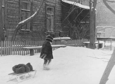 little girl pulling sleigh