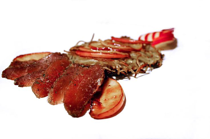 Cured Pork with Caramelized Apples on a bead of Potato Paillasson