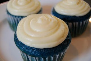 Easy Blue Velvet Cupcakes.  Maybe I'll do yellow frosting with blue sugar sprinkles?