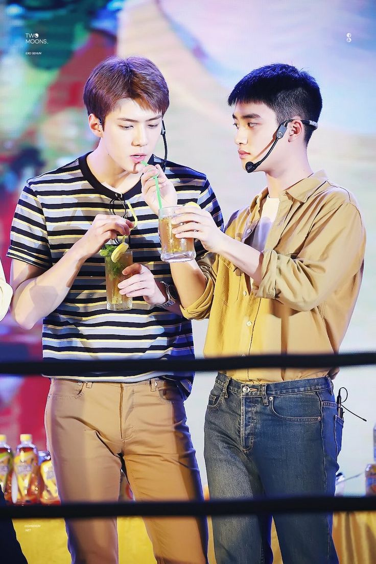 Why does D.O look like as if he's luring Sehun to drink that because it has some poison made by him..? Can't you all just look at his 'you're going to die' stare?