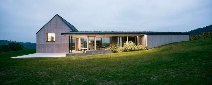 Embedded in the mellow, undulating landscape of Southern Styria sits House T, right on top of a hill, where it naturally blends in with the surrounding viney...
