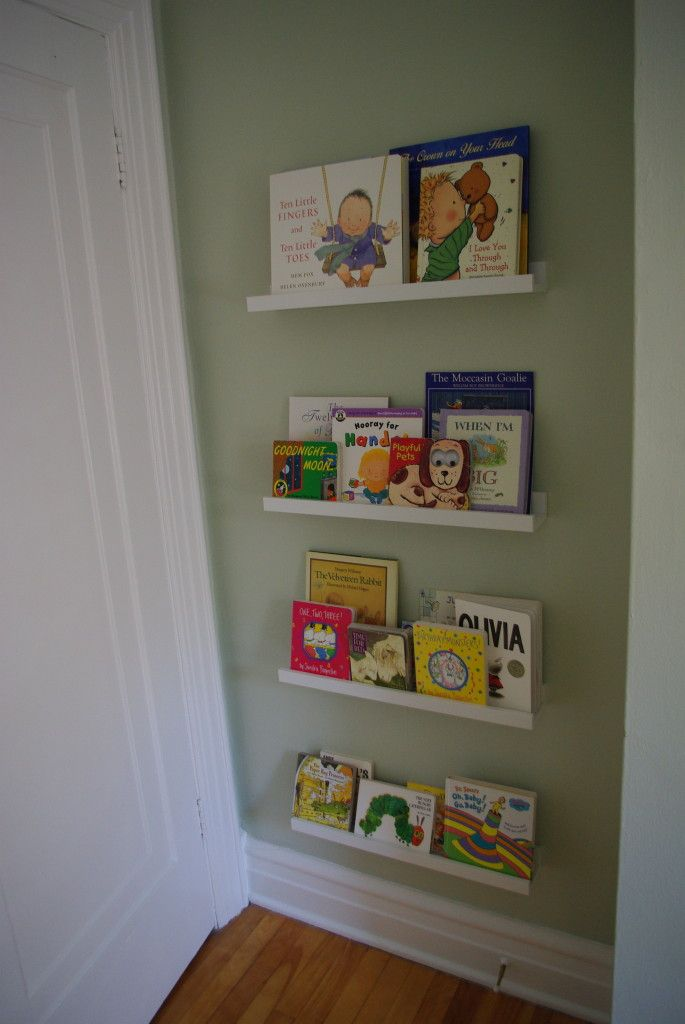Great low profile bookshelf option for the nursery (Ribba picture shelf / book shelves from Ikea)