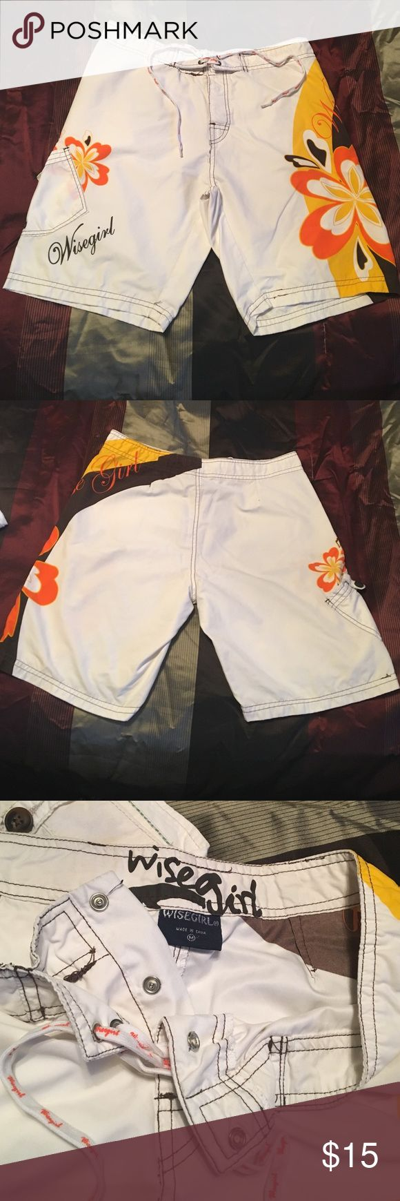 🌊Wise Girl Board Shorts White wise girl board shorts, with brown, yellow, and orange patterns on both sides of the shorts. Pocket on the right side while worn. Front snaps and ties for a secure fit. Laces are in great shape, no pulls or fraying. Shorts are also in great shape, barely worn. Material is like a men's swim trunk material. 100% polyester. Size medium, waistband is approx. 32 inches around. Wise Girl Swim