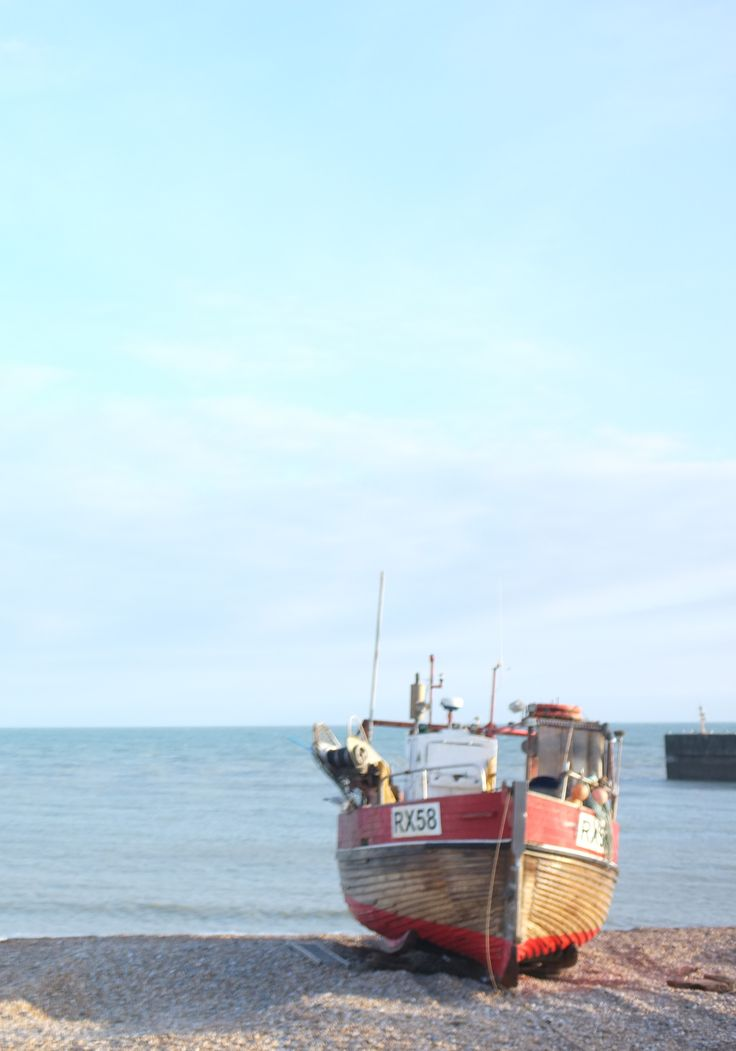 Sun, sun and classic boats on Hastings beach.