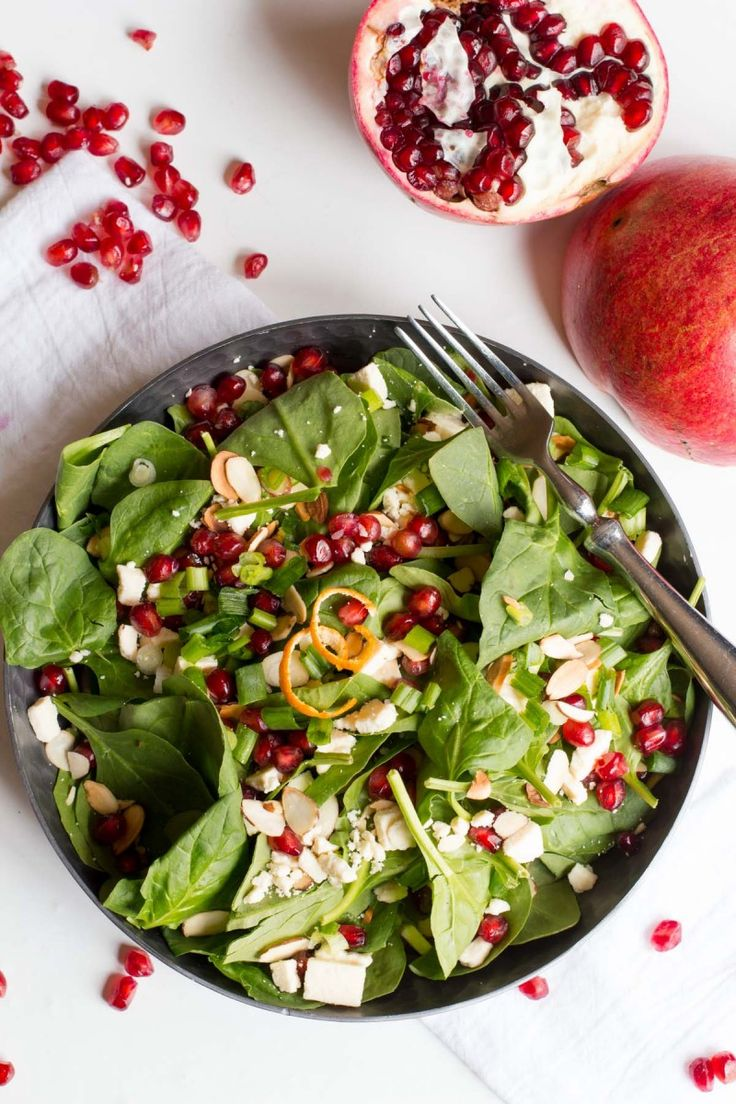 This bright and colorful Spinach Pomegranate Salad is packed with flavor, color, and nutrition! It's a great way to get back on track for the new year.
